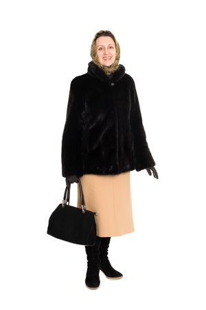 Happy elegant woman in a short fur coat of mink. photo