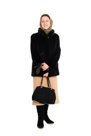 Smiling elegant woman in a short fur coat of mink. photo