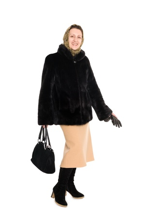 Cheerful elegant woman in a short fur coat of mink. photo