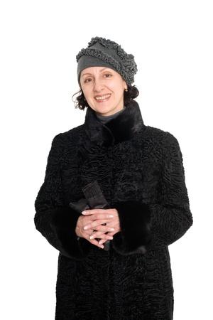 Smiling woman in a fur coat from broadtail (karakul, astrakhan, lambskin). photo