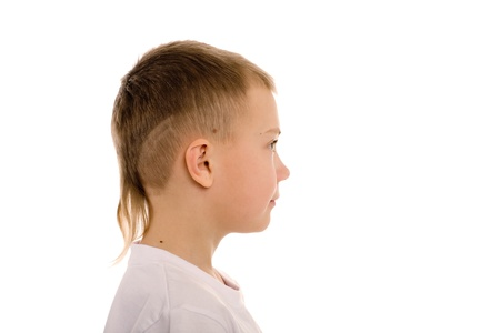 Boy of eight years in profile. Children photo