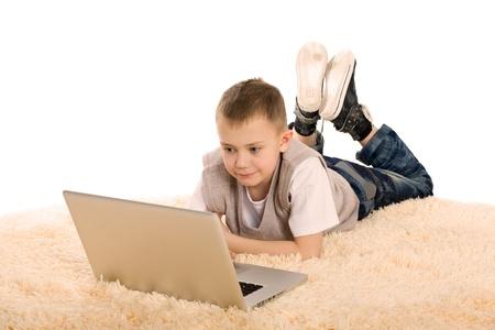 Portrait of a cute boy using a laptop. photo