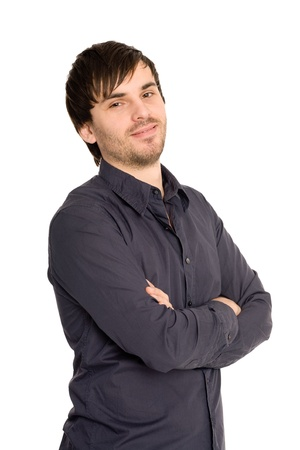 Handsome young man smiling over white background with hands folded