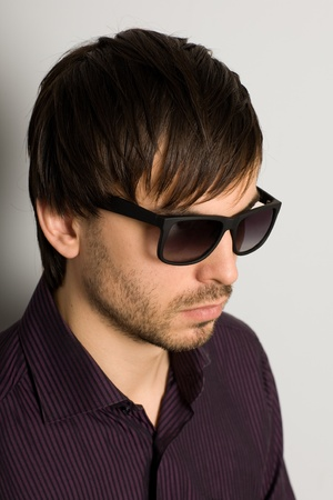Fashionable young man in sunglasses photo