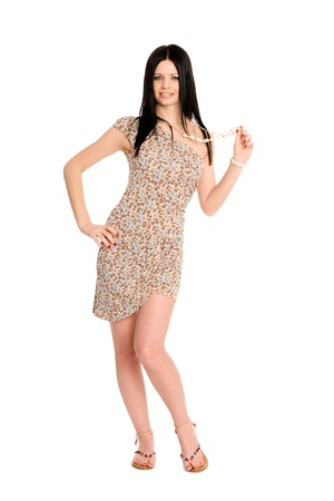 Attractive young brunette in a summer dress photo