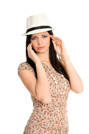 Beautiful young brunette in a summer dress and hat photo