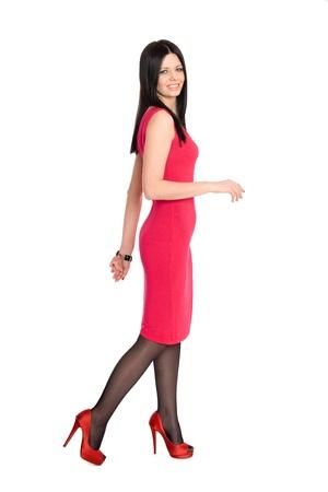 Walking pretty happy girl in high heels Stock Photo