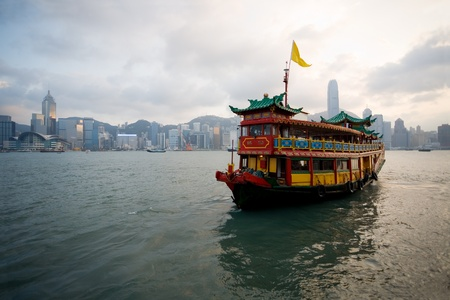 Cruise ferry in traditional Chinese style in the port of Hong Kong. Evening. September, 2011. Stock Photo - 12710485
