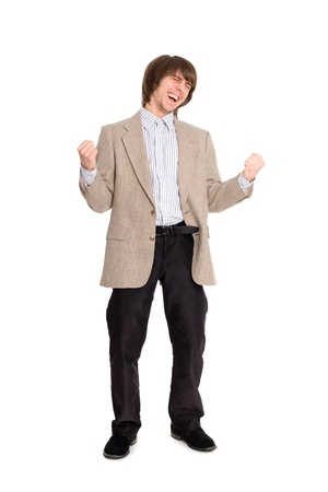 Excited young business man on a isolated white background photo