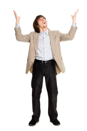 Joyful young business man with arms raised  photo