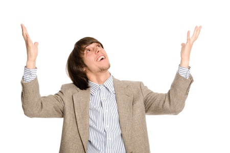 Enthusiastic young business man with arms raised  photo