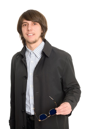 Young business man in a raincoat photo