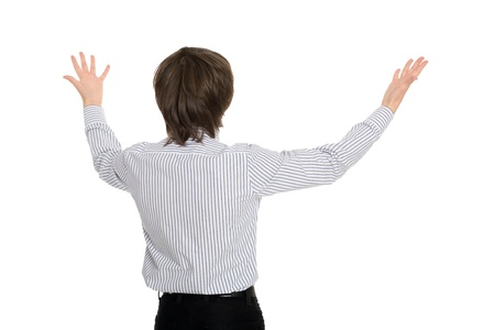 young man standing with his back in delight has spread his hands  photo