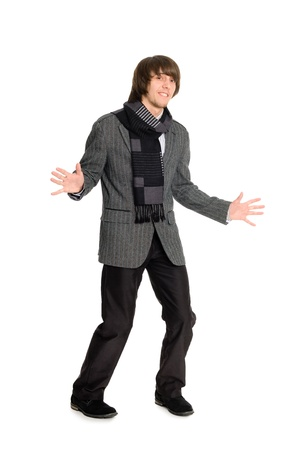 Cheerful young man dancing on a white background. photo