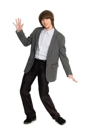 Dancing stylish young man on a white background. photo