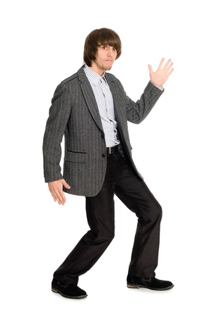 Dancing stylish young man in a gray jacket photo