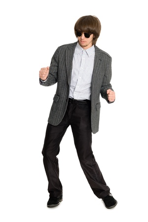 Dancing stylish young man on a white background photo