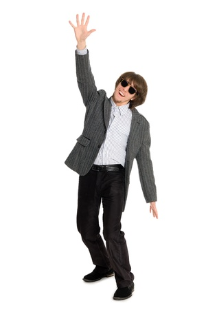 Enthusiastic young businessman with his hand extended upwards. photo