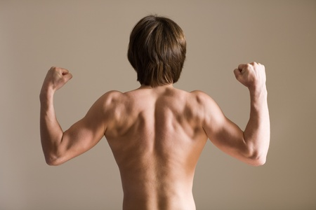 beefcake: Back of the young man athletic