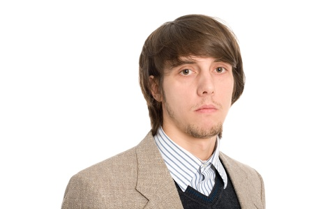 Elegant serious young businessman with long hair and short beard photo