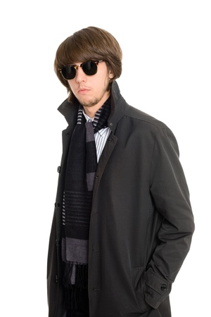 Stylish young man in a raincoat photo
