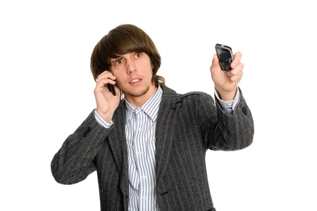 stockbroker: Young stockbroker talking on a mobile arm and points to the side.