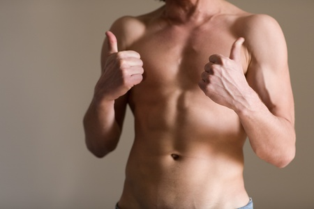 beefcake: Athletic body of a man with natural light Stock Photo
