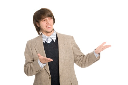 Joyful young businessman pointing hands on anything. photo