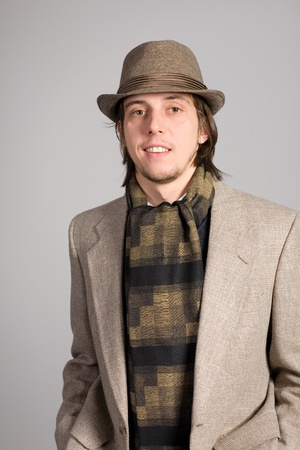 Smiling young man in a jacket and hat photo