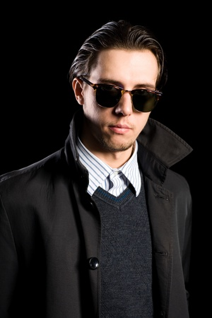Portrait elegant young man in sunglasses photo
