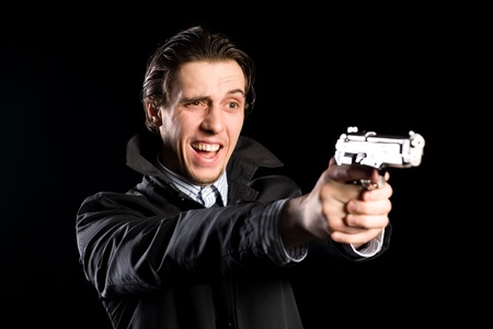 Aggressive shouting man firing a pistol photo