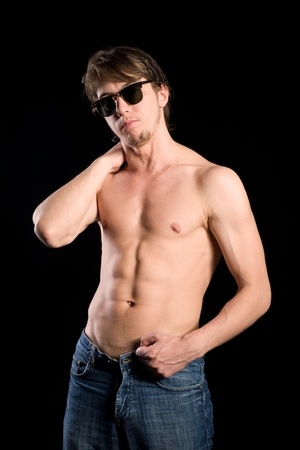 Handsome young man in sunglasses with a naked torso photo