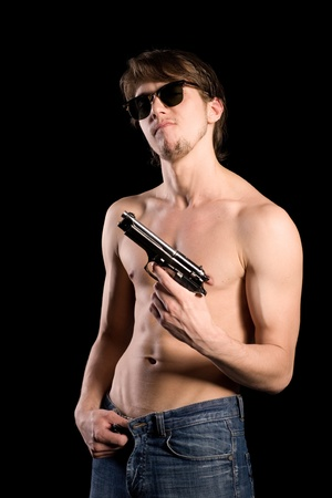 Young handsome man holding a gun photo