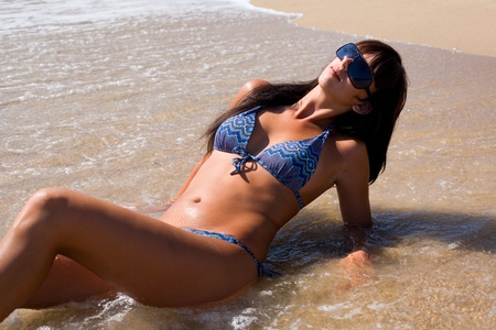 Beautiful tanned girl in a wave of the sea Stock Photo - 13074905