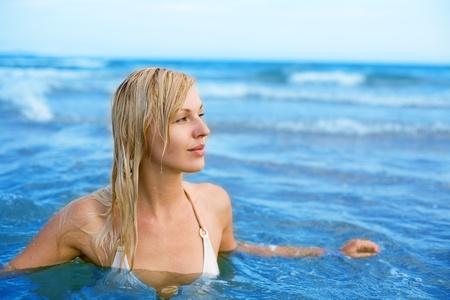 Beautiful girl swims in sea. Tropic.