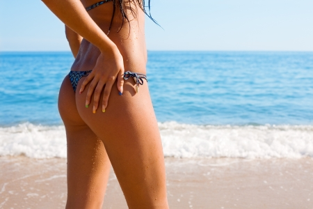 thong woman: Slim tanned figure girl against the sea