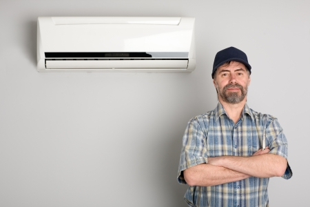 Master of repair air conditioners. Stock Photo - 13634641