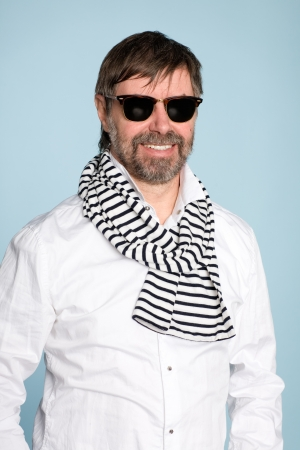 Smiling middle aged man wearing sunglasses photo