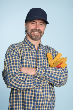 Cheerful middle aged man in a baseball cap. photo