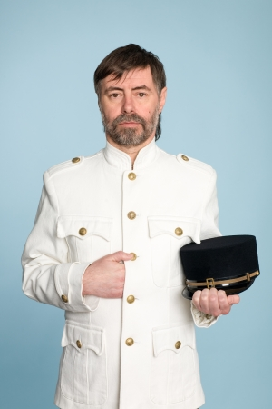 Middle aged man in the form of a naval officer with a cap photo