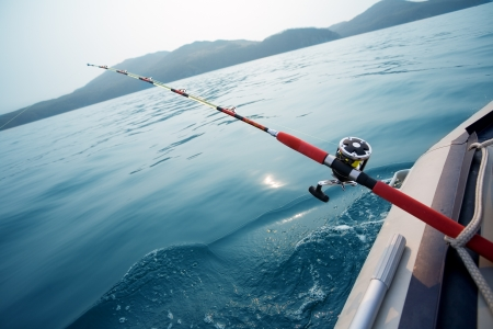 Salmon trolling in Sea Japan. Early in the morning. photo