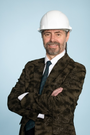 Happy smiling middle aged businessman in a helmet. photo