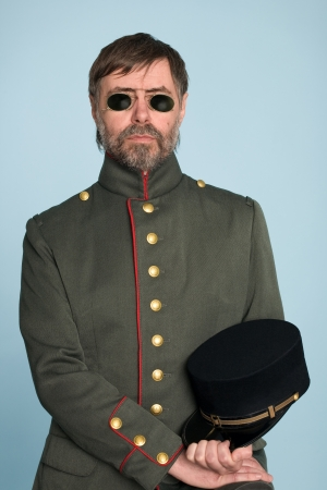 Man in the uniform of a military officer in the pince-nez. photo