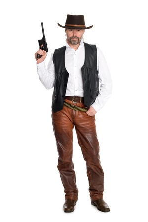 Middle aged man in leather pants with a gun. photo