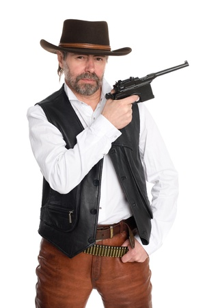 Middle aged man in a cowboy hat with a gun. photo