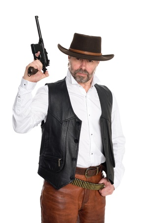 Middle aged man in a cowboy hat hold a gun. photo