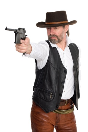 Man in cowboy hat shot from a pistol. photo