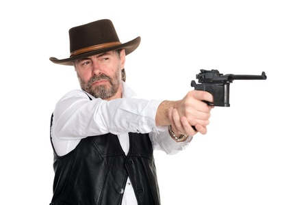 Man in a cowboy hat shot from a pistol. photo