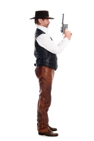 Man in a cowboy hat with a gun photo