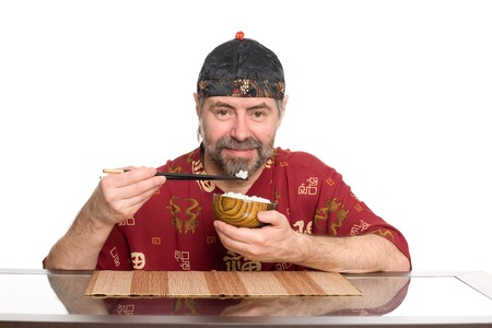 Caucasian in traditional Chinese attire eating rice from a wooden plate Stock Photo - 13845584